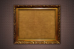 Gold frames on the wall Stock Images