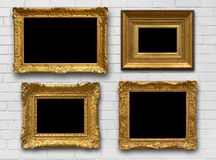 Gold Frames on Brick  Wall. Gold antique frames on white brick wall Stock Images