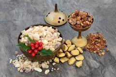 Gold Frankincense and Myrrh with Holly stock image