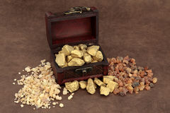 Gold Frankincense and Myrrh. And an old wooden box over brown lokta paper Stock Photography