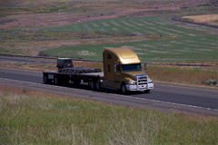 Gold Freightliner / Loaded Flatbed Stock Photo