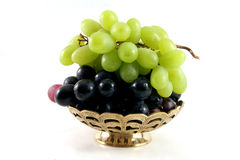 Gold fruit dish with grapes Stock Photography