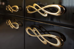 Gold furniture handles Royalty Free Stock Image