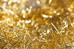 Gold garland for the Christmas tree. Selective focus Royalty Free Stock Photo
