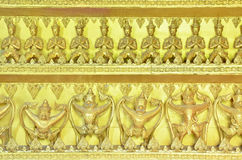 Gold Garuda and buddha statues Royalty Free Stock Photos