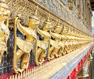 Gold Garuda wall at thai templte Stock Photos