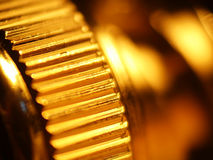 Gold Gear. Closeup of small metal gear-like ridges on a video connector Stock Photos