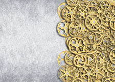 Gold gear, industrial background of the mechanism of wheels with Royalty Free Stock Images