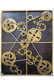 Gold gear wheels with chains. Close up of gold metal cog wheels bound with chains Stock Image