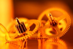 Gold gears. Old clockwork - macro with a depth of field Royalty Free Stock Photos