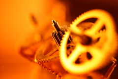 Gold gears. Old clockwork - macro with a depth of field Royalty Free Stock Images
