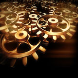 Gold gears and cogs macro Royalty Free Stock Photos