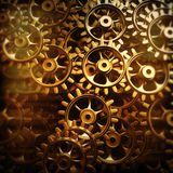 Gold gears and cogs macro. 3D Royalty Free Stock Photos