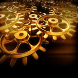 Gold gears and cogs macro. 3D Royalty Free Stock Photography