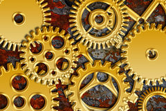 Gold Gears on Grunge Texture Background Stock Photo