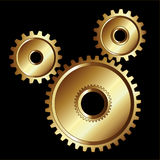Gold gears machinery tools Royalty Free Stock Image