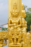 Gold giants statue. Royalty Free Stock Images