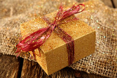 Gold gift Royalty Free Stock Photography