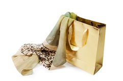 Gold gift bag and  green silk scarf isolated on white Royalty Free Stock Image
