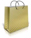 Gold gift bag Royalty Free Stock Photos
