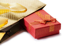Gold gift bag and red gift box isolated on white. Selective focu Royalty Free Stock Images