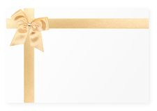 Gold gift bow. On white card Royalty Free Stock Image