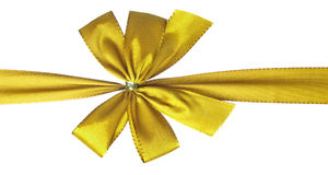 Gold gift bow. Isolated on white Royalty Free Stock Photography