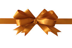 Gold gift bow ribbon isolated on white background straight horizontal closeup Royalty Free Stock Image