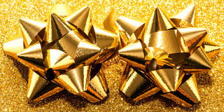 Gold gift bows Stock Images