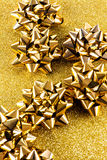 Gold gift bows Royalty Free Stock Photos