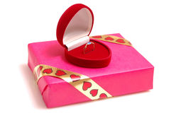 Gold in a gift box Stock Image