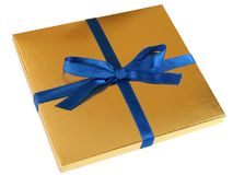 Gold gift box - 4. Close up view of a gold gift box with blue bow isolated on white background stock photo