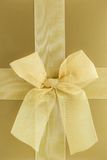Gold gift box. With bow close up Stock Photo