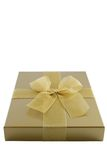 Gold gift box. With bow isolated on white Stock Photography