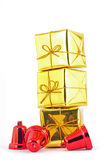 Gold gift box and bell on white or gray background. Gift box and bell on white or gray background Stock Images