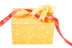 Gold gift box with bow isolate Stock Photography