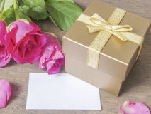 Gold gift box with card and rose Royalty Free Stock Photo