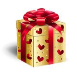 Gold Gift Box Christmas Holiday. Gold Gift box isolated on white background, shine Red ribbon, hearts decorative pattern, gold, red color. For Christmas, New Stock Photo