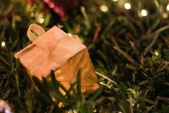 Gold Gift Box Christmas and New year decorations, soft focus. Gift Box Christmas and New year decorations, soft focus Royalty Free Stock Images