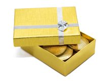 Gold gift box with gold coins royalty free stock images