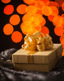 Gold Gift box with gold ribbon Royalty Free Stock Images