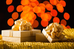 Gold Gift box with gold ribbon Stock Image