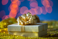 Gold Gift box with gold ribbon Royalty Free Stock Photography