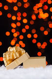 Gold Gift box with gold ribbon Royalty Free Stock Photo