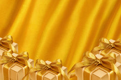 Gold Gift Box on gold satin Royalty Free Stock Photography