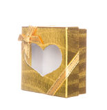Gold gift box with heart shape isolated on white Stock Image