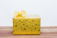 Gold gift box with knot Stock Photo
