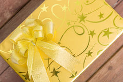 Gold gift box with knot Royalty Free Stock Image