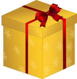 Gold gift box with red bow Royalty Free Stock Image