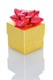 Gold Gift Box with Red Bow Royalty Free Stock Photo